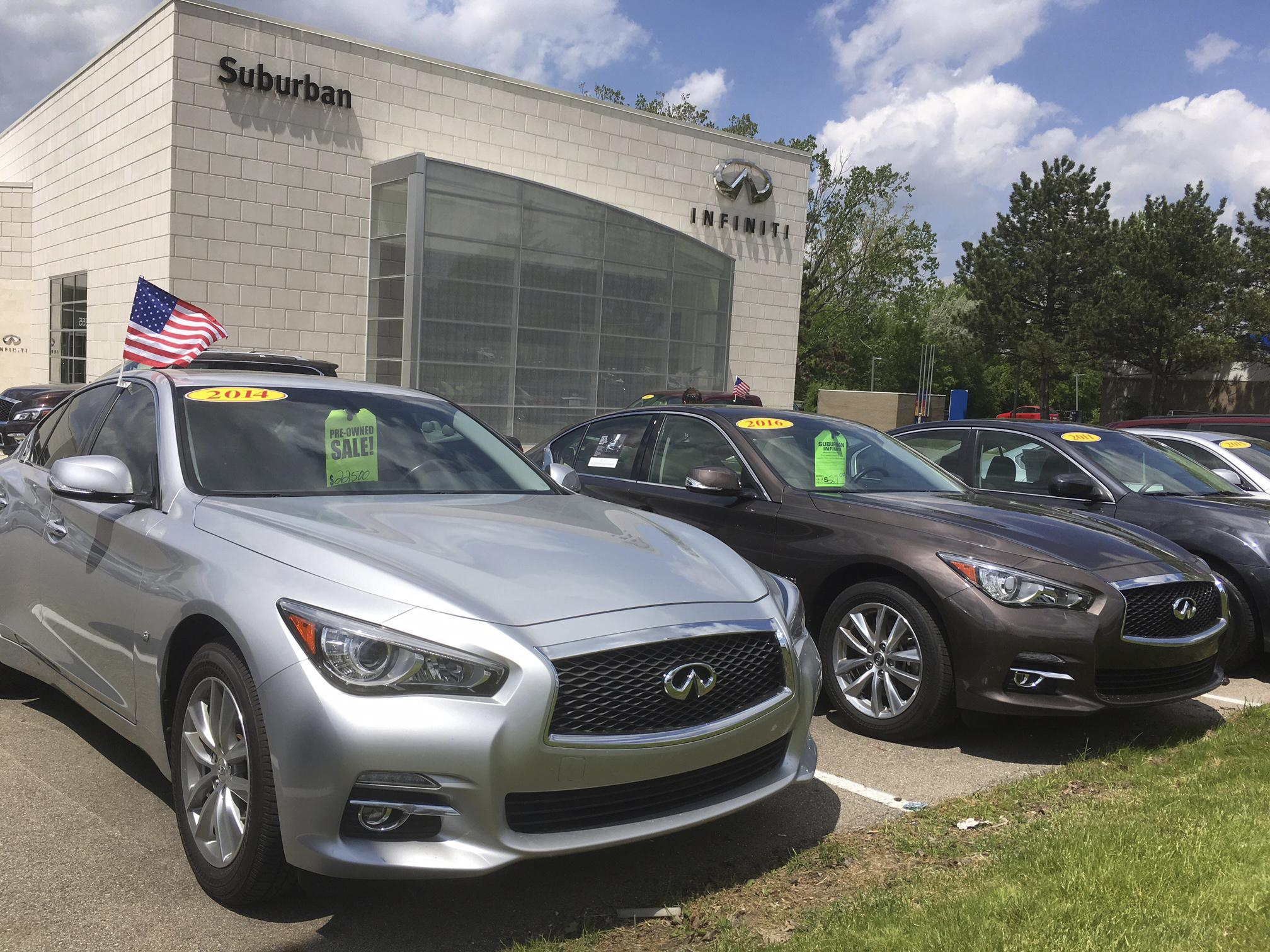 used infiniti q50 luxury sedans await ers at a dealership in the detroit suburb of novi