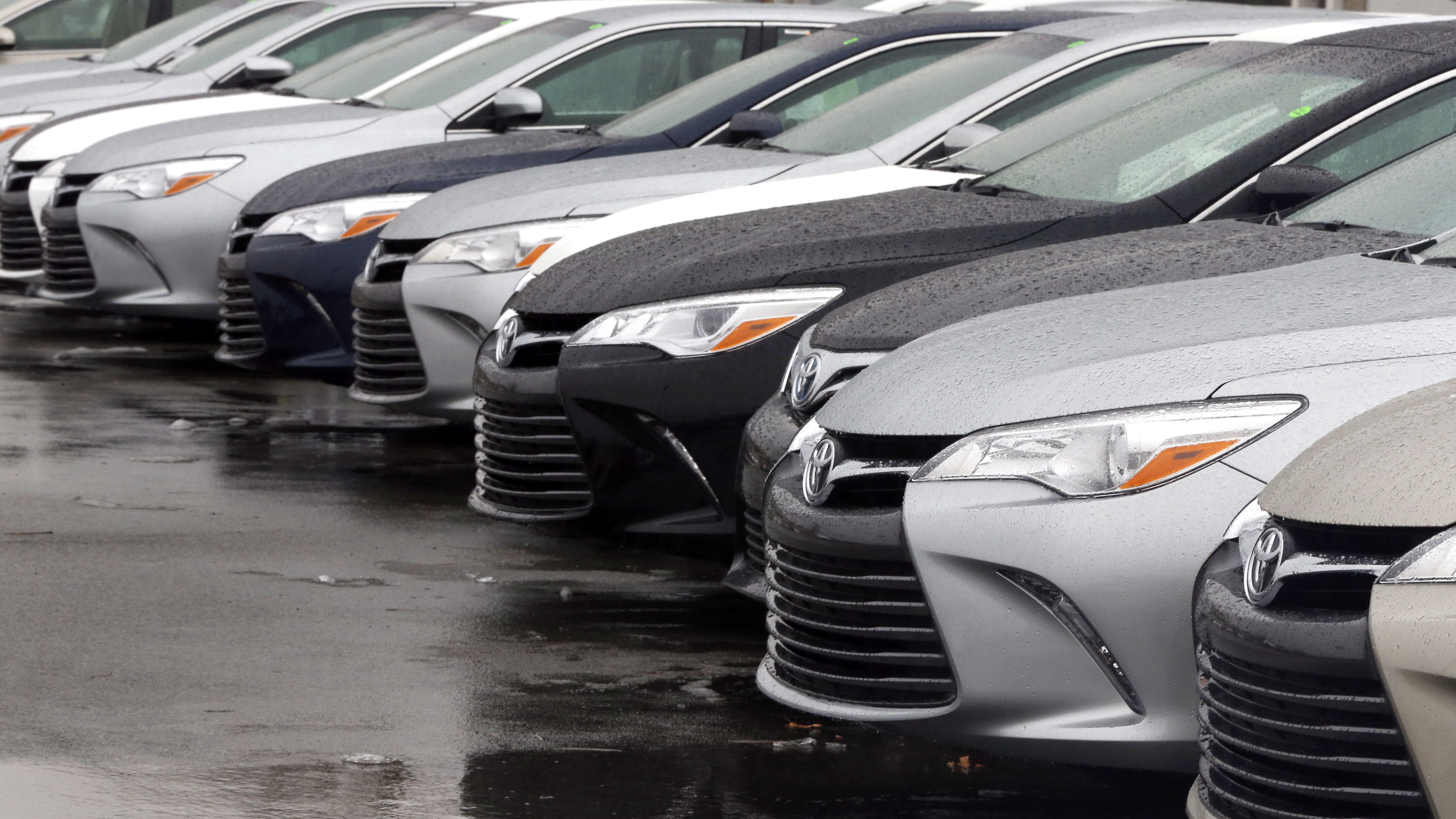 toyota cars for sale are parked at a dealership in danvers mass federal reserve policymakers left rates unchanged wednesday which should keep down the