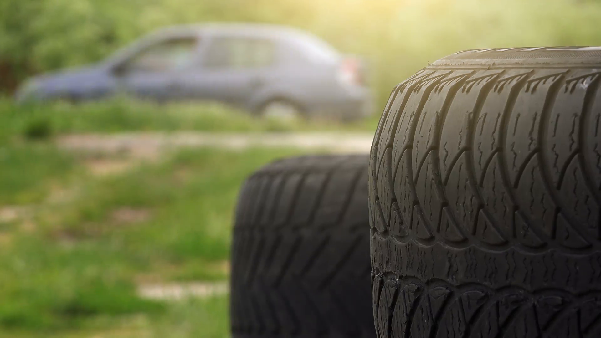 close up of obsolete used car tires with blur traffic in background stock video footage videoblocks