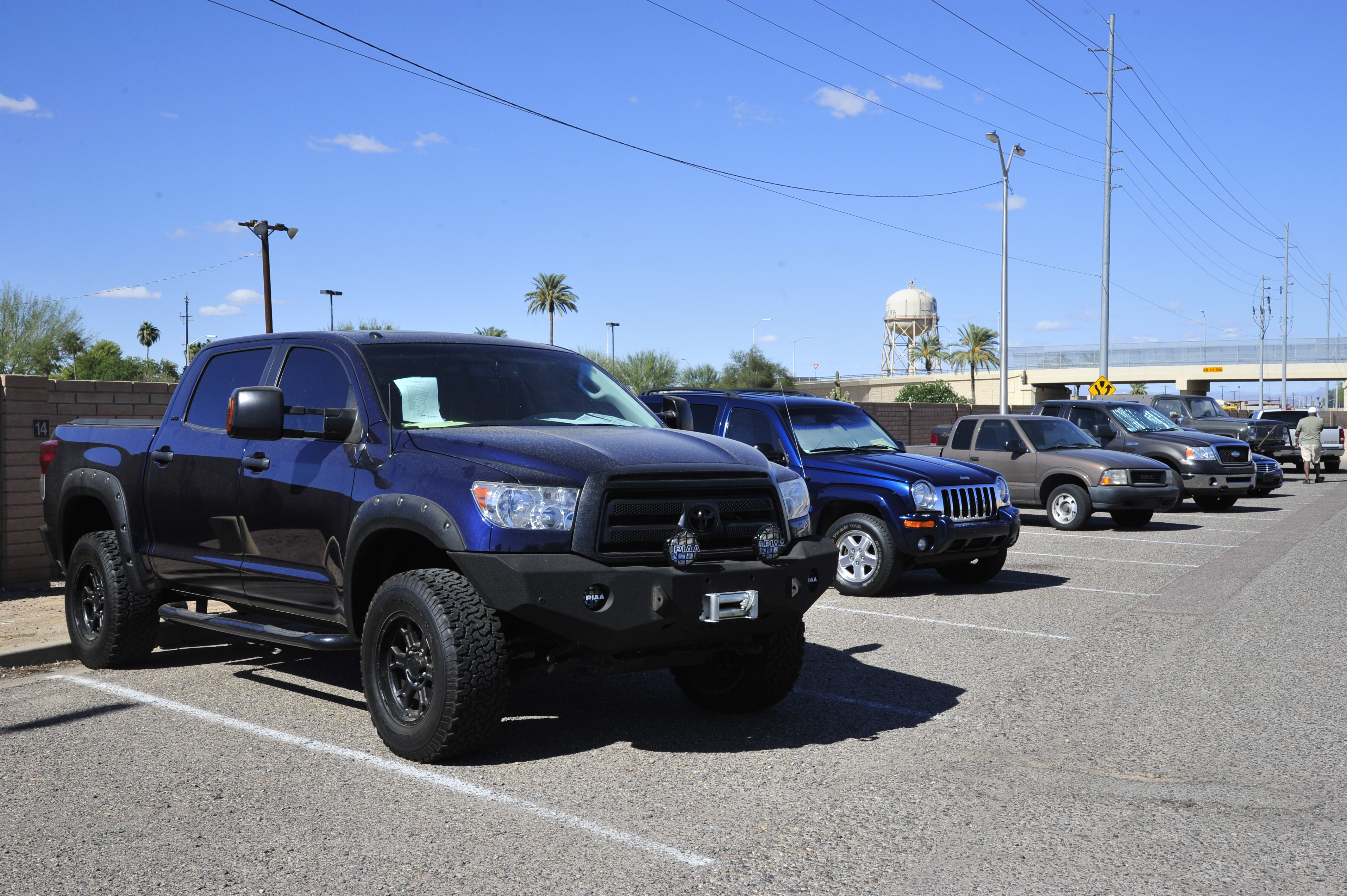 a variety of used cars are for sale at the luke air force base lemon lot