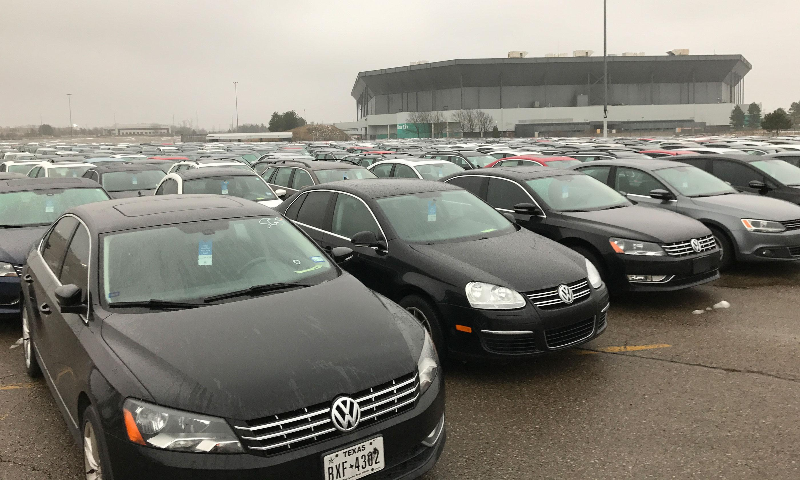 thousands of vw and audi models with sel engines are being stored at a former stadium used by the detroit lions in pontiac mich north of detroit