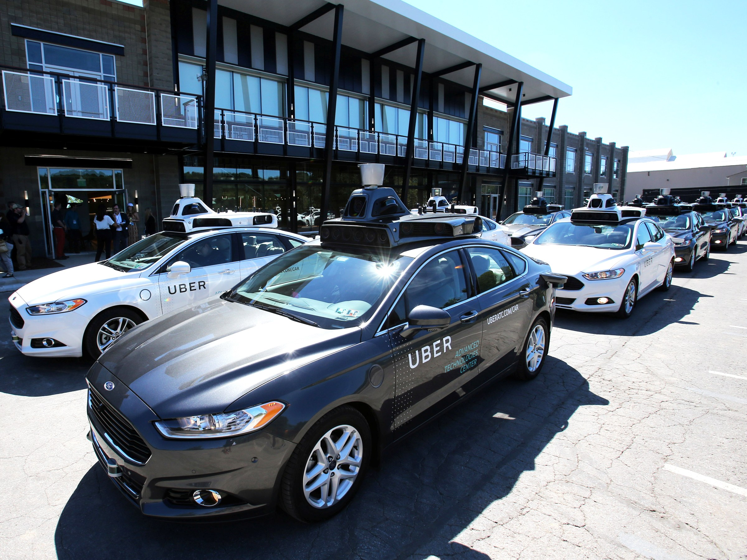 a fleet of uber s ford fusion self driving cars are shown at uber s advanced technology group center in pittsburgh pennsylvania