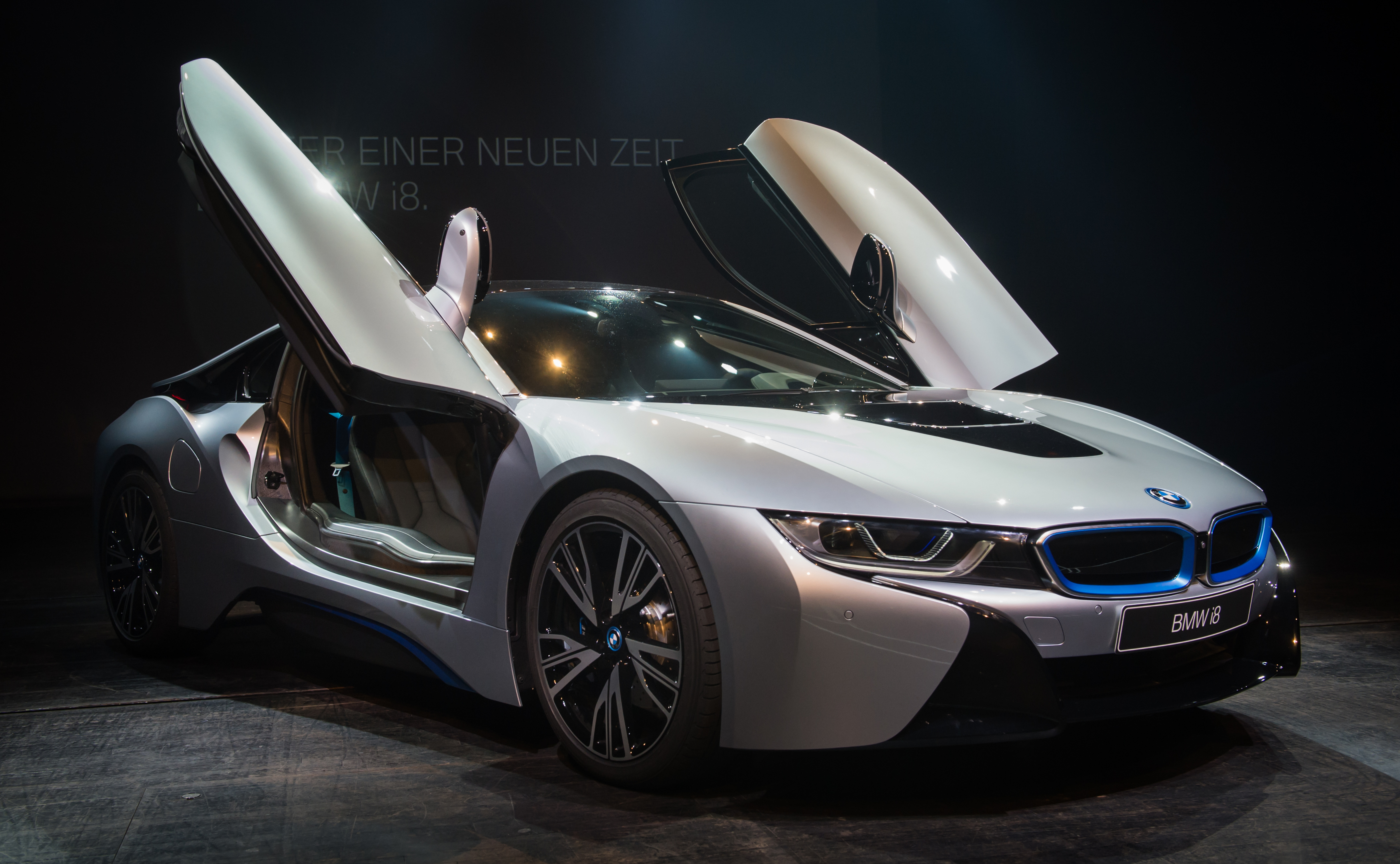 a bmw i8 plug in hybrid sports car is displayed at bmw world on june