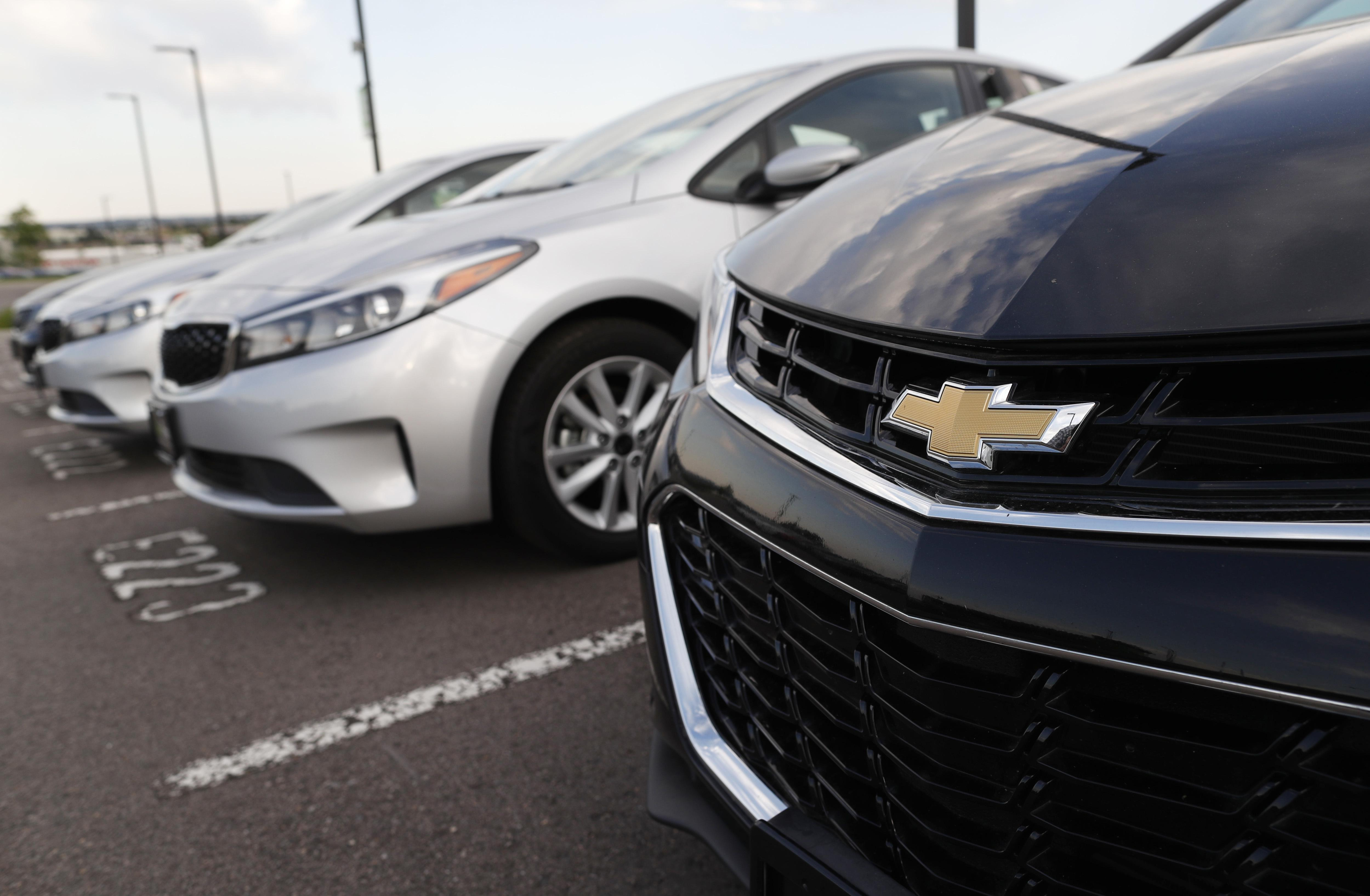 """the corporate """"bowtie"""" logo shines on the grille of a used 2017 chevrolet cruze"""