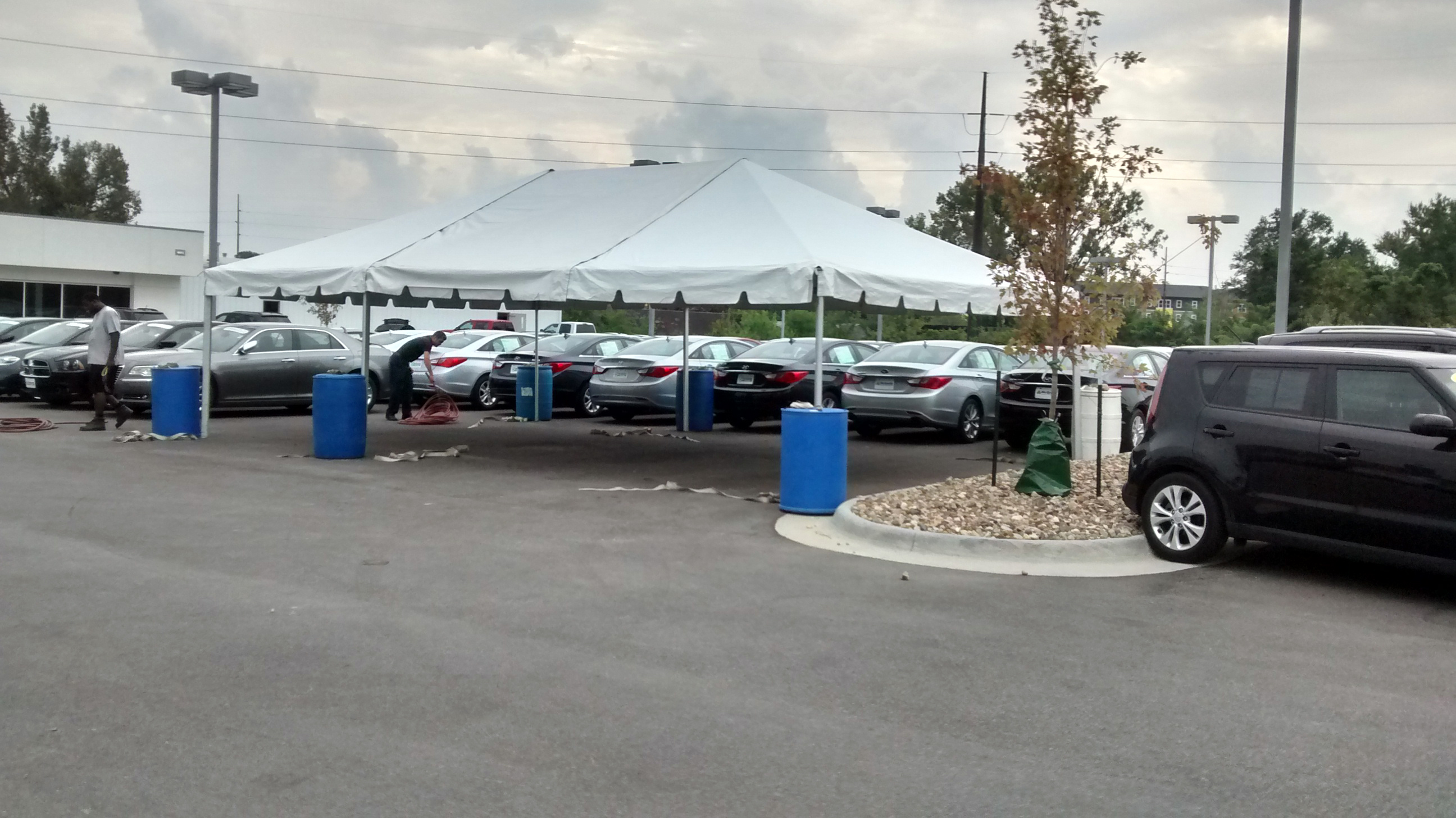 finished 20′ x 30′ frame tent for the grand re opening at coralville used car superstore