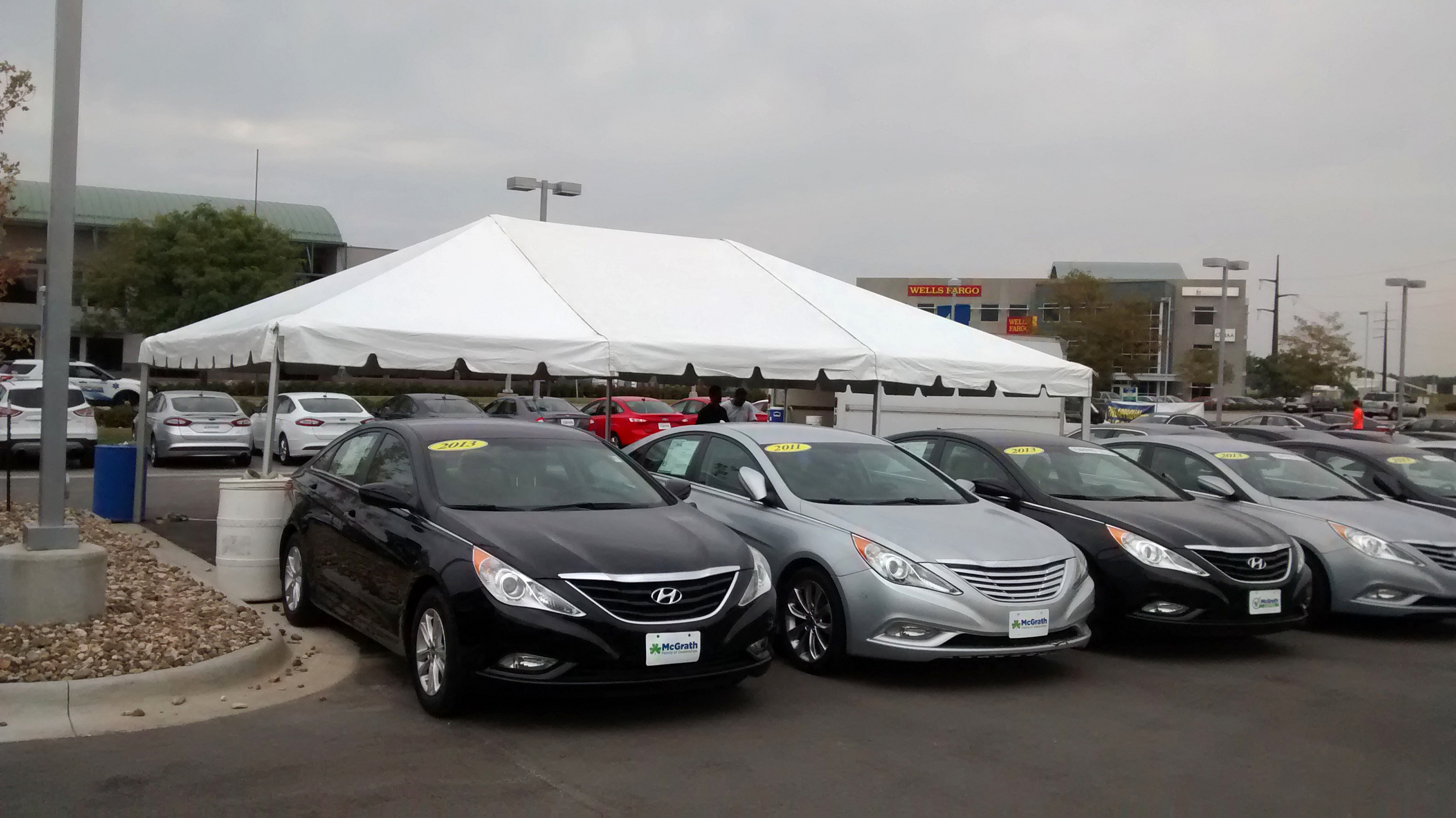 20′ x 30′ frame tent for the grand re opening at coralville used car superstore