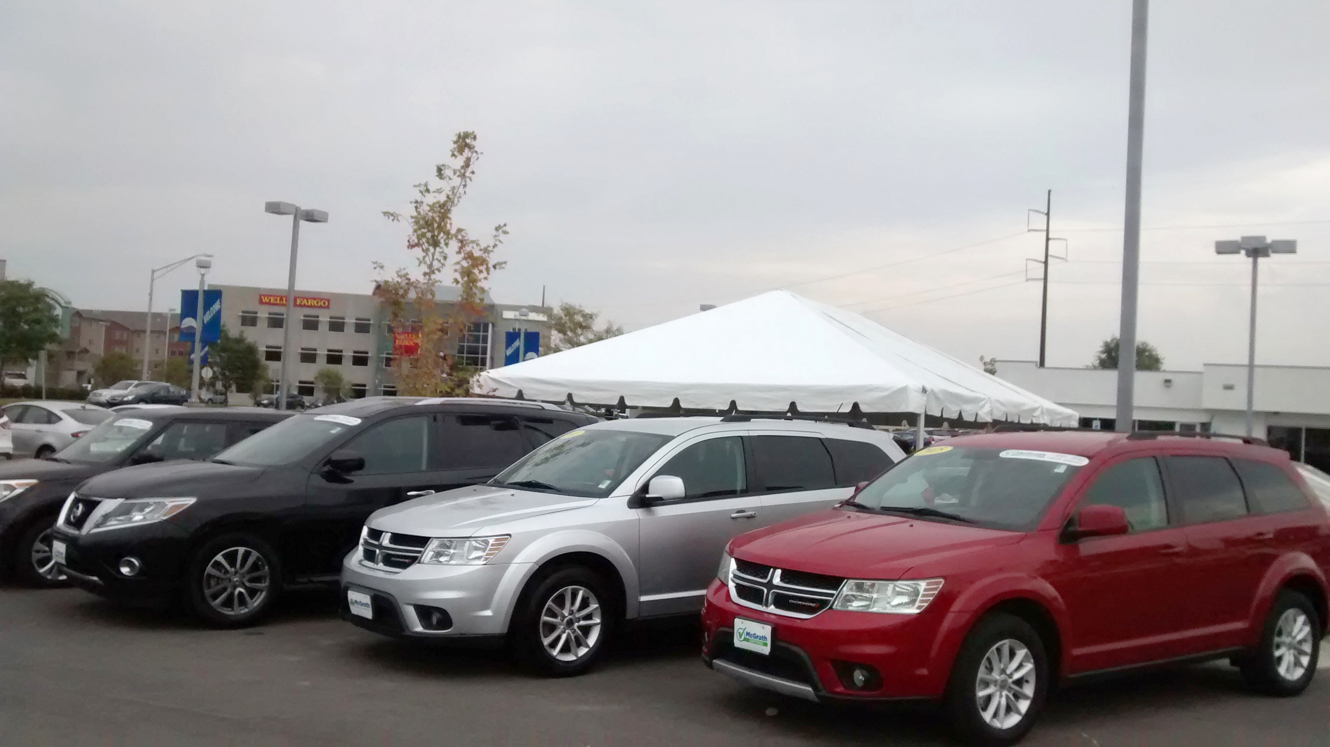 end of 20′ x 30′ frame tent for the grand re opening at coralville used car superstore
