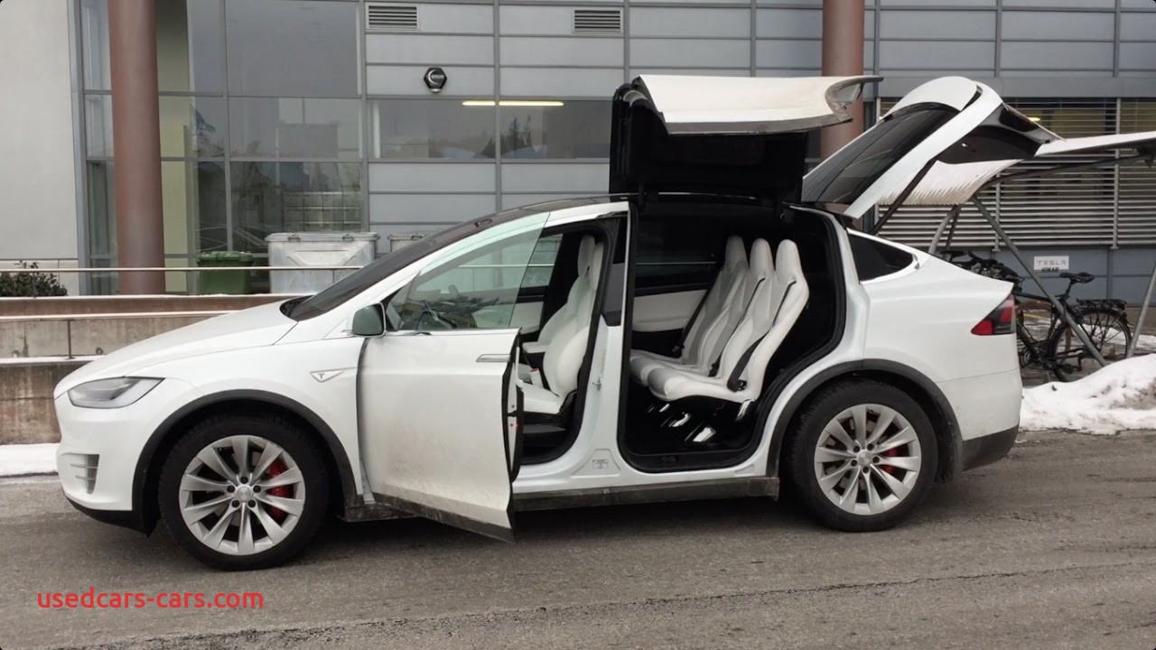 Tesla with butterfly Doors New Tesla Model X Falcon Wing Doors Tested In Tight Garage