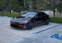 Least Expensive Tesla New Tesla Model S with Cryptic Deep Crimson Paint Spotted at