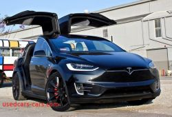 Lovely Tesla with butterfly Doors