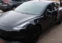 Tesla with Rims Beautiful Blacked Out Tesla Model 3