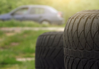 Used Car Tires Luxury Close Up Of Obsolete Used Car Tires with Blur Traffic In Background