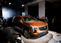 Used Cars Under $5000 New Cadillac Courts the Young and Rich with Crucial Pact Suv Sfgate